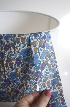 Step by step instructions to make your own fabric covered lampshade.