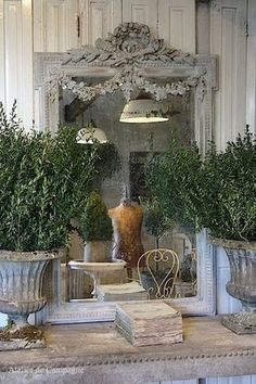 French Country Home. Love this French mirror and urn. #frenchcountry #mirrors