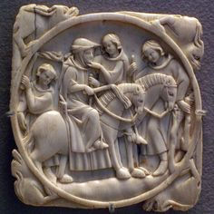Decorated Medieval Ivories in the Louvre- Ivory cover/back for a mirror with the scene of a couple touching. Paris, 14th century.