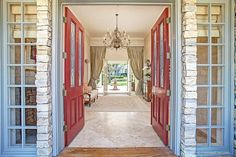 Make sure to take your shoes off at the front door before crossing into this magnificent entry with marble floors and Persian rug.