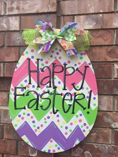 Looking for the most aDOORable Easter door hanger? Youve found it! This large Easter Egg door hanger is a combination of Chevron and Polka Dots with bright Easter colors and completed with a bow! For customization, choose from a variety of word options to make this door hanger all your own! This door hanger is sure not to disappoint! You are for sure to have the cutest porch this Easter season with this door hanger!  For additional questions/concerns, please CONTACT me prior to purchase ...