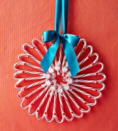 Pepermint candy, a piece of cardboard, and a hot-glue gun are all you need to make this festive #Christmas wreath.