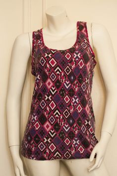 #Vintage #1980s/ #1990s #OP (Ocean Pacific) #purple #racerback #tribal #diamond #chunky #print #tank #top from the late #80s or early #90s. It has large armholes, making perfect for wearing over a #bandeau or #bralette. If you are a size #small, this would probably make a killer mini #tankdress or #beach cover.  #beachwear #hipster #retro #chunkyprint #dress #oceanpacific #summer #tanktop #pink #spring #tribalprint #boho #bohemian #cochella #gypsy #hippie #hippy