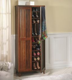 Gladwyn Shoe/Accessory Cabinet from Midnight Velvet®. An exquisitely crafted home for your shoes and accessories, this handsome cabinet not only organizes but beautifies. Accented doors with curved handles provide access to your shoes, handbags, hats and other items.