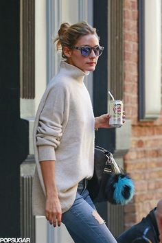 Olivia Palermo accessorized her outfit with mirrored tortoise sunglasses, a black crocodile satchel, and a Fendi keychain.
