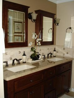 Love the separate medicine cabinets for each sink - Would do this in lighter colors, though