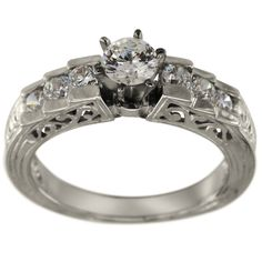 Vintage Filigree Channel Diamond Engagement Setting -  This engagement setting can hold any size or shape diamond.       This versatile ring has brilliant channel set round accent diamonds       Theengraving and the openwork give this it thedistinct appearance of antique style rings.            Dacarli has been manufacturing diamond jewelry for three generations, since 1939. The characteristics of such rings are milgrain, engraving and scrollwork. At Dacarli emphasis is...