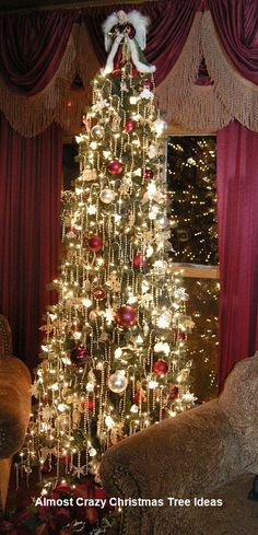 I'll Cross That Leg When I Get To It.: Christmas Decorations, Gifts and Retreat Announcement! Love this Elegant Christmas Tree with Pearl Tassels! Beautiful Christmas Trees, Elegant Christmas, Noel Christmas, Victorian Christmas, Winter Christmas, Christmas Lights, Tall Skinny Christmas Tree, Christmas Mantles, Office Christmas