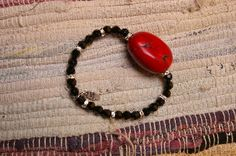 Black Glass Beaded Stretch Bracelet with a coral stone bead