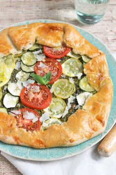 This beautiful free-form galette is the perfect way to celebrate fresh, seasonal summer vegetables — all tucked into an easy crust with a thick smear of fresh, aromatic pesto.