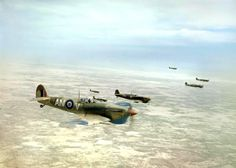 Supermarine Spitfire Mk Vbs of No. 417 Squadron, Royal Canadian Air Force, flying in loose formation over the Tunisian desert on a bomber escort operation, April 1943