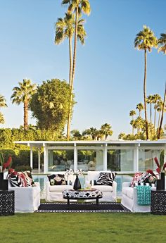 Inside out. Capture the look of a chic interior with all-weather cushions and easy-care slipcovers. Bold colors and black accents make this especially Palm Springs-esque. Chic!  | Frontgate: Live Beautifully Outdoors