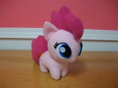 Pinkie Pie Chibi Pony  *** Lovingly hand crafted fan art ***    ~ Ponies are carefully and lovingly made to order which usually takes 1 to 3 days, thanks! ~    Made from very soft and cuddly fleece. I decided to go with carefully cut felt for the eyes because I wanted a more 3d look compared to iron on or patch eyes. The eyes and cutie marks are glued on with a high quality fabric glue. I put a lot of sewing detail into her hair and tail. Im happy with how she turned out.    Pinkie Pie is…