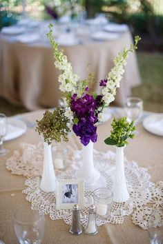 Milk glass bud vases and doilies for a simple, delicate, and inexpensive centerpiece. #centerpiece #wedding