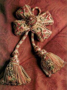L'Art de la Passementerie; ornate decorative tassel in dusty cinnabar