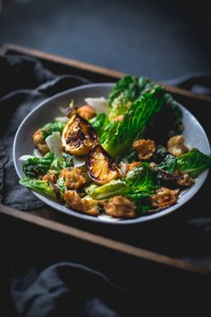 Caesar Salad Recipe with Homemade Croutons | Adventures in Cooking   This delicious Caesar salad involves a touch of smokiness from charred lemon and a bit of smoked paprika, along with all the other Caesar goodness! #caesar #salad #homemade #croutons #paprika #charred #lemon #adventuresincooking