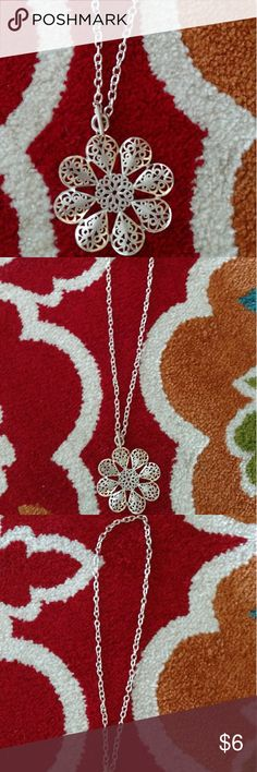 Silver Necklace with Flower Pendant Gently worn once. In new condition. If measurements needed or any questions, let me know.   Please make me an offer as my closet is ALWAYS negotiable Jewelry Necklaces