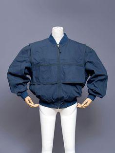 Issey Miyake dark blue layered bomber jacket with velcro pocket closures, 1980s.