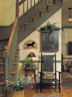 Lovely country-rustic entrance hall ... grey staircase and woodwork works well with black, parchment and natural materials and the overall sense of a heritage property which this looks supports.