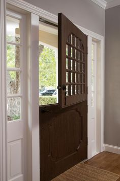 Fixer Upper hosts Chip and Joanna Gaines kept the original Dutch front door and painted it with a faux finish to look like a dark stained wood grain.