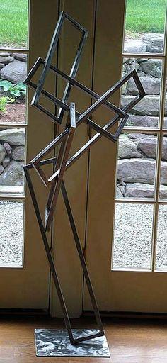 simple geometric sculpture, metal garden art