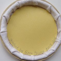 How to frame your cross stich in an embroidery hoop.