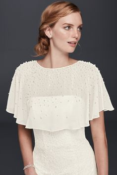Pearl and Crystal Chiffon Capelet with lustrous gems dot this airy chiffon to add coverage and pretty details to your wedding dress! Shop at David's Bridal