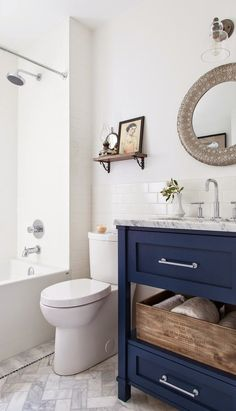 6th Street Design School : Feature Friday: The House Diaries: navy bathroom vanity in a white bathroom: