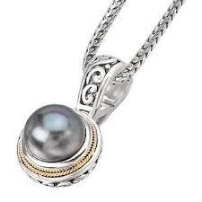 black  pearl (10mm) necklace is set in s/s  and has 18 kt. yellow gold accents.