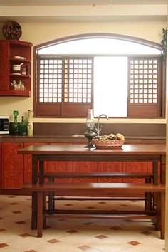 While a kitchen may exude the look of the traditional, everything in it can still be brand new. The choice of furniture, something traditionally Pinoy but made of lighter materials, helped in achieving a modern bahay-na-bato look throughout the property. Modern Filipino Interior, Modern Filipino House, Contemporary Interior Design, Home Interior Design, Future House, Filipino Architecture, Philippine Houses, Bali, House And Home Magazine