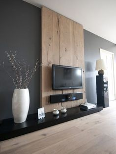 Minimalist Living Room: Get rid of furniture you don't need. Hang your TV on the wall. Entertainment centers often encourage you to add unnecessary items to fill up space. Learn more at: http://www.minimalistguy.net/home/minimalistlivingroom