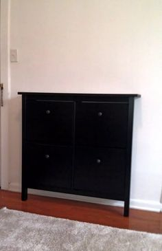 Thin shoe holder (IKEA Black/Brown-$49.99) turned TV stand for small-space living! :)
