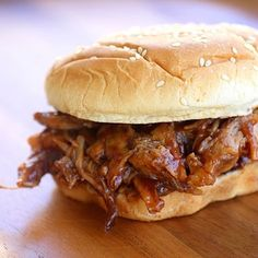 """Place a 2-lb pork tenderloin in a slow cooker, pour a 12-oz can of root beer over it and cook on high for 6 hours. Discard juice, cover pork with 1 18-oz jar bbq sauce and heat until sauce is warm. Serve on buns."