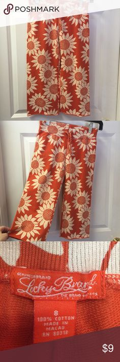 Girl's Cropped Pants Cute girl's cropped pants by Lucky Brand. Size 8, these pants have a drawstring waist & are cropped to hit half-way up the calf. Spring & summer will be colorful with these pretty orange w/white daisy capris! Lucky Brand Bottoms Casual