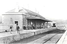 Eskbank Railway Station c.1885. Note the gas lights and brackets on the wall of the station and the original sandstone capping of the platform wall.  Goods shed in the background. Image copyright owner: State Records NSW