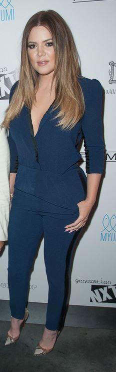Khloe Kardashian: Jumpsuit – By Malene Birger  Shoes – Christian Louboutin  Purse – Chanel