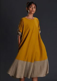 Handwoven mustard dresses MTCA This handwoven Mustard dress is designed to make you look more classy and stylish. *A Fun dress made with a combination of two colours *Umbrella cut giving it a beautiful flow *Turn up sleeve of a contrast fabric *Wooden buttons for closure *Circular dress *Product length-44""