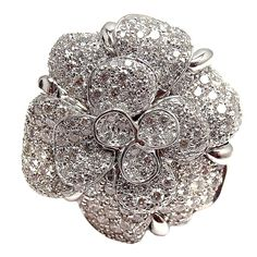 """18k White Gold Diamond Large Camelia Flower Ring by Chanel. From the Chanel """"Camelia"""" Collection. This ring is a current model and available for purchase through Chanel's website REFERENCE NUMBER: J1076. With 250 round brilliant cut diamonds, VVS1 clarity, E color. This ring comes with an original Chanel box."""