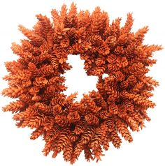 Orange Pinecone Wreath This gorgeous pinecone wreath is built to bring in the holiday cheer. Handmade on our family farm each wreath is built to last many years. After each pinecone is carefully secur