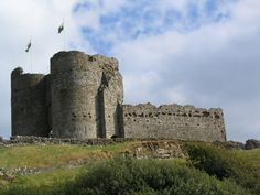 Criccieth Castle sits on the headland overlooking Tremadog Bay in Criccieth, North Wales. It towers over the town of Criccieth to this day. The Castle was founded by the Welsh Prince Llywelyn ap Iorwerth (Llywelyn Fawr), and extended by Llywelyn ap Gruffudd (Llywelyn the Last).