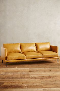 Premium Leather Linde Sofa #anthropologie  Pretty!  Love the lager color for a sitting room or office space.