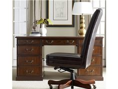 """The 60"""" Knee-hole Desk is crafted from hardwood solids cherry veneers and leather."""