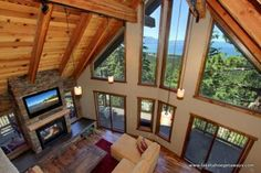 Floor to ceiling fireplace, tall ceilings, and scenic windows.. perfection.