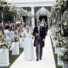 Brides.com: . Tricia Nixon and Edward Cox, July 1971. President Richard Nixon hosted his eldest daughter Tricia's outdoor ceremony to law student in the White House's Rose Garden. Since Tricia was the more reserved of the two Nixon girls, many were surprised that her wedding was such a spectacular affair. The reception was held in the East Room. Tricia wore a gown designed by Priscilla of Boston