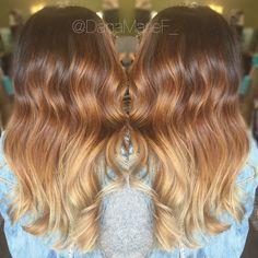 Colormelt balayage warm tones curly long hair