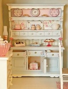 A super cute shabby chic storage area, this is such a beautiful piece of furniture!