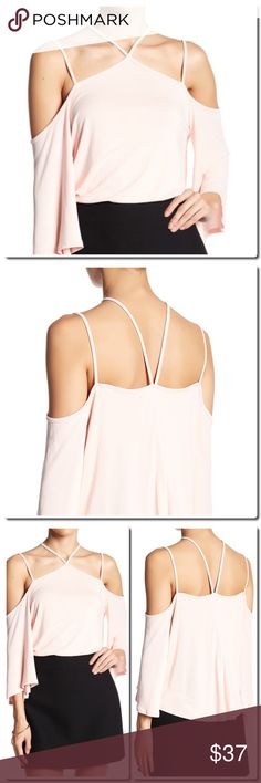 """Cold Shoulder Criss Cross Blouse - Halter neck - 3/4 length bell sleeves with shoulder cutouts - Crisscross strap detail - Slips on over head - Solid stretch construction - Approx. 22.5"""" length - Made in USA Fiber Content 78% modal, 22% polyester Care Dry clean only Additional Info Fit: this style fits true to size.  Model's stats for sizing: - Height: 5'9"""" - Bust: 34"""" - Waist: 25"""" - Hips: 35"""" Model is wearing size S. Lush Tops"""