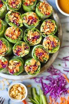 Vegetable Spring Rolls with Peanut Sauce - Simple, healthy and fresh with the creamiest peanut sauce ever. Prep ahead of time and use up lingering veggies! rolls Vegetable Spring Rolls with Peanut Sauce Vegetable Spring Rolls, Vegetarian Recipes, Cooking Recipes, Delicious Recipes, Peanut Sauce, Peanut Butter, Clean Eating Snacks, Appetizer Recipes, Dinner Recipes