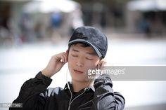 ストックフォト : Young man is listening to music