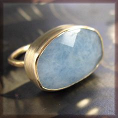 Aquamarine is worn to reawaken love in long-term relationships. It represents beauty, honesty, loyalty, love and intelligence. What a perfect stone to use as a second ring when a couple renews their vows!